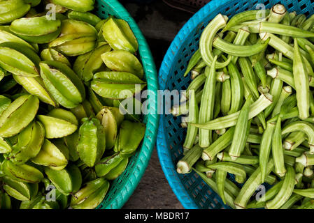 Baskets of star fruits and okra - Stock Photo