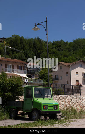 A small green work truck parked in San Lorenzo, Italy - Stock Photo