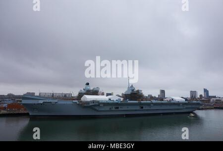 Port view of Royal Navy HMS Queen Elizabeth under maintenance in Portsmouth, UK - Stock Photo