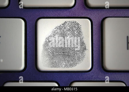 Image of fingerprint icon on computer keyboard button - Stock Photo