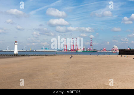 Looking over the beach at New Brighton and the lighthouse at the Wirral Peninsula to the river Mersey. - Stock Photo
