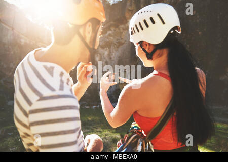 Rock climbers with camera phone - Stock Photo