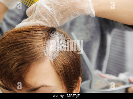 Beauty salon. Hairdresser dye  hair of female client - Stock Photo