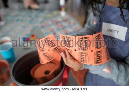 Girl selling fundraising raffle tickets - Stock Photo