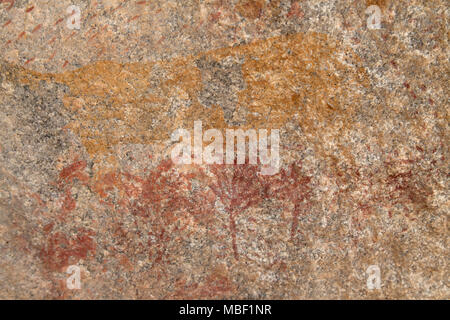 Ancient rock art at Matobo National Park in Zimbabwe. The painting depicts an animal and trees. - Stock Photo