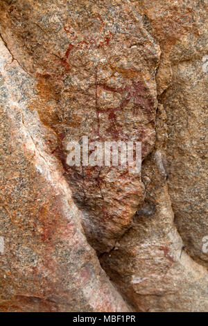 Ancient rock art at Matobo National Park in Zimbabwe. The painting depicts an animal. - Stock Photo