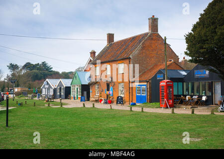 Walberswick Suffolk, view of a row of shops on the village green in the centre of Walberswick, Suffolk, England, UK. - Stock Photo