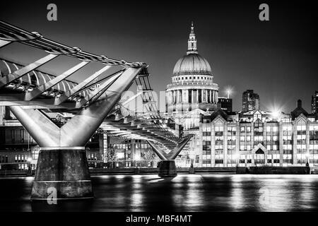 The Millennium Bridge and St. Paul's Cathedral in London at twilight. - Stock Photo