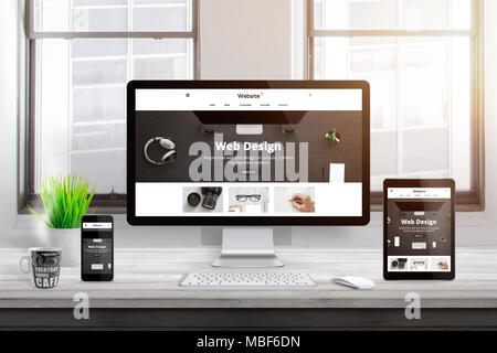 Modern responsive flat web site design presentation on computer, tablet and smart phone display. Office desk. Window and sun light in background. - Stock Photo
