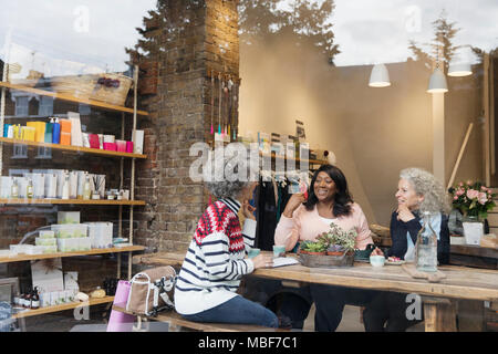 Women friends drinking tea at cafe shop - Stock Photo