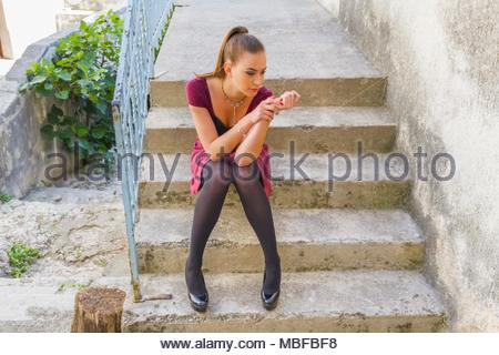Teenager female girl legs Black tights pumps stiletto shoes - Stock Photo