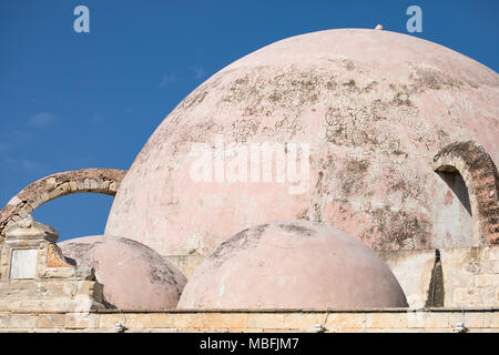 The dome, cupola of an old mosque in Chania, Crete, Greece. Blue sky in background. - Stock Photo