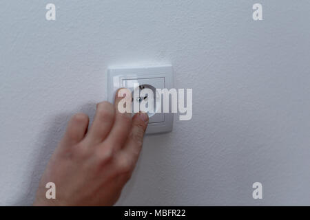 Sockets - Connect the wires during home renovation on white wall - Stock Photo
