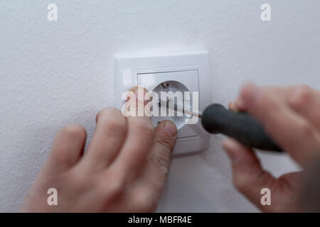 White sockets - Connect the wires during home renovation on white wall - Stock Photo