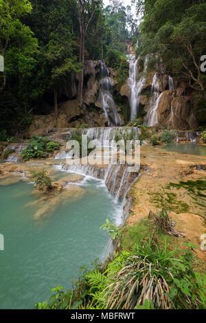 Side view of the beautiful main fall at the Tat Kuang Si Waterfalls near Luang Prabang in Laos. - Stock Photo