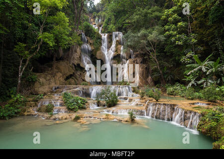 Beautiful view of the main fall at the Tat Kuang Si Waterfalls near Luang Prabang in Laos. - Stock Photo