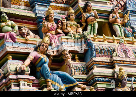Horizontal close up of the many statues on the roof of Sri Muthumariamman Temple in Matale, Sri Lanka. - Stock Photo