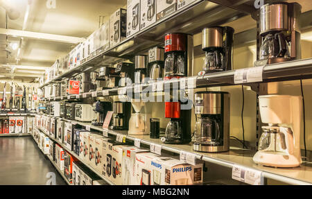 Display of kitchen appliances such as coffee machines or microwaves in a french electrical goods store. - Stock Photo