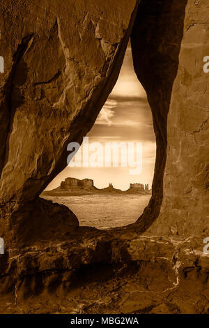The Saddleback, the King on his throne and the stagecoach buttes seen through the Teardrop Arch in Monument Valley Navajo Tribal Park, Utah. - Stock Photo