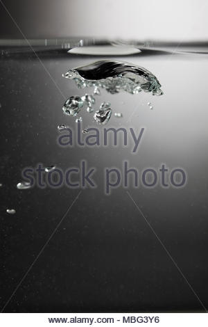 Water bubbles rising to the surface - Stock Photo