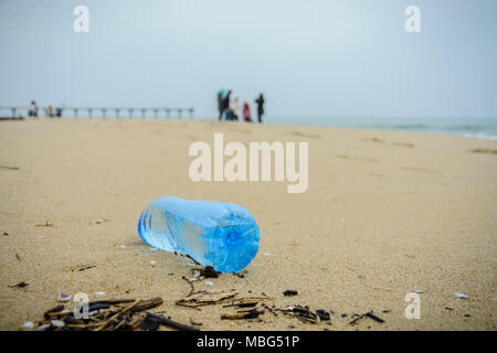 dirty plastic bottle dropped on the beach - Stock Photo
