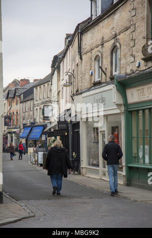 Saturday shoppers strolling down a street in the Cotswold town on Cirencester Gloucestershire England - Stock Photo