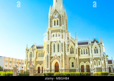 Majestic Victorian Gothic Reformed Mother Church in Graaff-Reinet, Eastern Cape, Great Karoo, South Africa. Facade of historical Dutch church, built 1886, in the city center. Sunny day, blue sky - Stock Photo