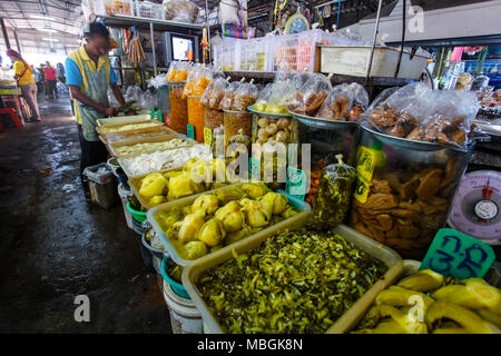 Khao Lak, Thailand - February 22, 2016: Variety of fresh fruit and vegetables products displayed on local food market in the morning. Thai cuisine is  - Stock Photo