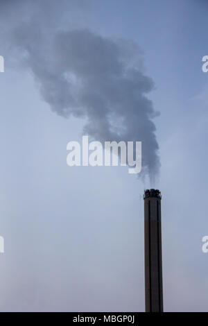 Chimney smoking stack. Air pollution and climate change theme. Poor environment in the city. Environmental disaster. Harmful emissions into the enviro - Stock Photo