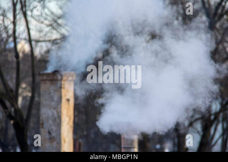 Smoking stack. Air pollution and climate change theme. Poor environment in the city. Environmental disaster. Harmful emissions into the environment. S - Stock Photo