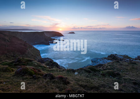 Looking towards Godrevy Lighthouse from The Knavocks on the Cornwall coast at sunset. - Stock Photo