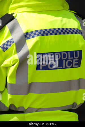 Hi visibility jacket work by a police office - Stock Photo