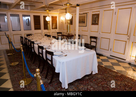 Officers' dining table near to the Captain's quarters / rooms on HMS Warrior. Portsmouth Historic Dockyard. UK. (95) - Stock Photo