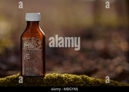 Natural remedies - medicines.  Brown bottle - natural therapy, health. - Stock Photo