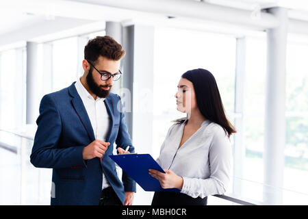 Business couple discussing about their job and planing how to success - Stock Photo