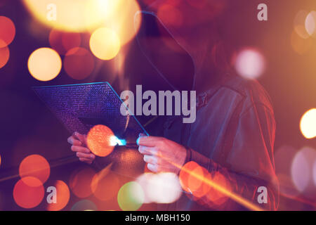 Computer hacker hacking artificial neural network with futuristic tablet computer, conceptual image - Stock Photo