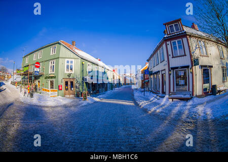 TRONDHEIM, NORWAY - APRIL 04, 2018: Traditional Scandinavian wooden living houses stand along old street in Trondheim, Norway - Stock Photo