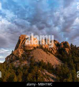 The faces of Washington, Jefferson, Roosevelt, and Lincoln at sunrise on Mount Rushmore in South Dakota. - Stock Photo