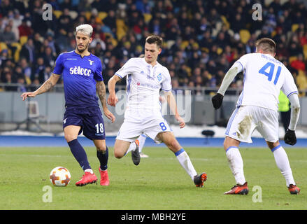 KYIV, UKRAINE - MARCH 15, 2018: Luis Alberto of SS Lazio (L) fights for a ball with Volodymyr Shepeliev of Dynamo Kyiv during their UEFA Europa League - Stock Photo