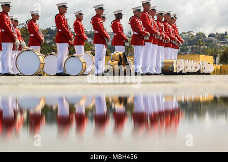 "Marines with ""The Commandant's Own,"" U.S. Marine Drum & Bugle Corps, perform during a West Coast tour performance at Marine Corps Recruit Depot (MCRD), San Diego, Ca., March 17, 2018. The audince members of the ceremony included many current recruits as well as drill instructors of MCRD San Diego. - Stock Photo"
