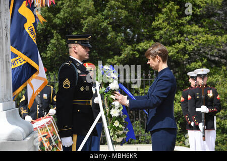 President of Estonia, Kersti Kaljulaid lays a wreath at the Tomb of the Unknown Soldier during an Armed Forces Full Honor Wreath Laying Ceremony in Arlington National Cemetery, Va., April 4, 2018. - Stock Photo