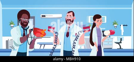 Team Of Medical Doctors Holding Equipment For Cardiac Resuscitation Over Hospital Ward Background - Stock Photo
