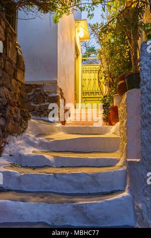 Street in Anafiotika neighborhood of Athens in Greece. - Stock Photo