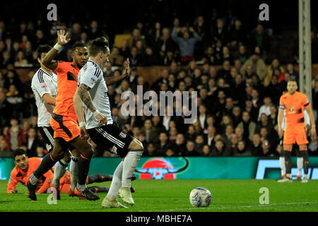 London, UK. 10th April, 2018. Stefan Johansen of Fulham (R) scores his team's first goal. EFL Skybet championship match, Fulham v Reading at Craven Cottage in London on Tuesday 10th April 2018.  this image may only be used for Editorial purposes. Editorial use only, license required for commercial use. No use in betting, games or a single club/league/player publications. pic by Steffan Bowen/Andrew Orchard sports photography/Alamy Live news - Stock Photo
