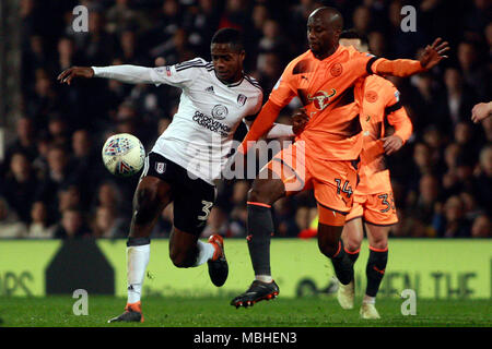 Ryan Sessegnon of Fulham (L) in action with Sone Aluko of Reading (R). EFL Skybet championship match, Fulham v Reading at Craven Cottage in London on Tuesday 10th April 2018.  this image may only be used for Editorial purposes. Editorial use only, license required for commercial use. No use in betting, games or a single club/league/player publications. pic by Steffan Bowen/Andrew Orchard sports photography/Alamy Live news - Stock Photo