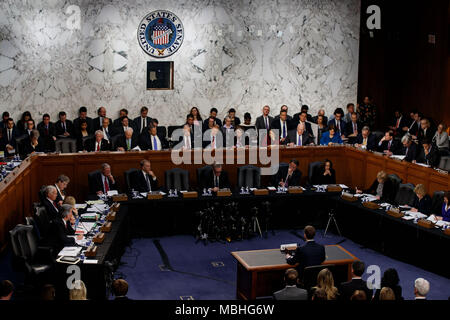 Washington, USA. 10th Apr, 2018. Facebook CEO Mark Zuckerberg testifies at a joint hearing of the Senate Judiciary and Commerce committees on Capitol Hill in Washington, DC, United States, on April 10, 2018. Facebook CEO Mark Zuckerberg told Congress in written testimony on Monday that he is 'responsible for' not preventing the social media platform from being used for harm, including fake news, foreign interference in elections and hate speech. Credit: Ting Shen/Xinhua/Alamy Live News - Stock Photo