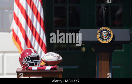 Washington, USA. 10th Apr, 2018. Ceremonial presentation helmet and football are on display at the welcoming ceremony of the 2017 NCAA Football National Champions: The Alabama Crimson Tide to the White House in Washington, DC, March 10, 2018. Credit: Chris Kleponis/CNP - NO WIRE SERVICE - Credit: Chris Kleponis/Consolidated News Photos/Chris Kleponis - CNP/dpa/Alamy Live News - Stock Photo