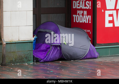 Northampton. 11th Apr, 2018. UK Weather: Another dull miserable day for the homeless having to live in a tent in Abington Street in the town centre. Credit: Keith J Smith./Alamy Live News - Stock Photo