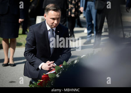 Warsaw, Poland on April 10, 2018.  Presdient Andrzej Duda and his wife Agata Kornhauser-Duda are seen during the wreath laying ceremony of the victims of the Smolensk crash on April 10, 2018 at the Powazki Military Cemetery in Warsaw, Poland. Credit: Jaap Arriens/Alamy Live News - Stock Photo
