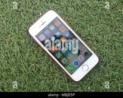 iPhone is a line of high-end smartphones designed and marketed by Apple Inc. It runs the iOS mobile operating system, known until mid-2010 as 'iPhone. - Stock Photo